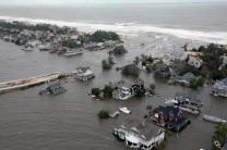 Storm surge from Hurricane Sandy beaches barrier island on New Jersey Coast. US Coast Guard